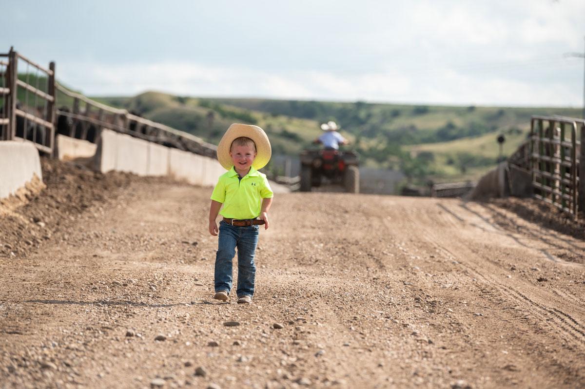 little boy in feedyard