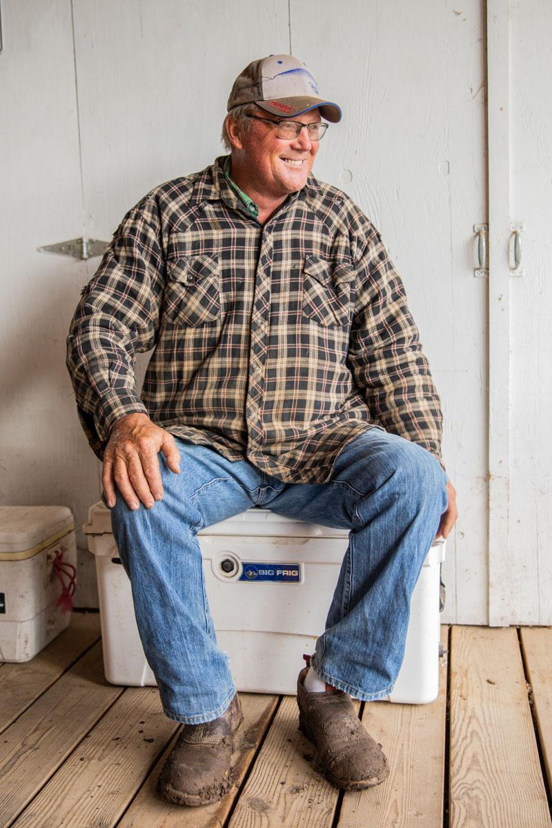 man smiling on porch